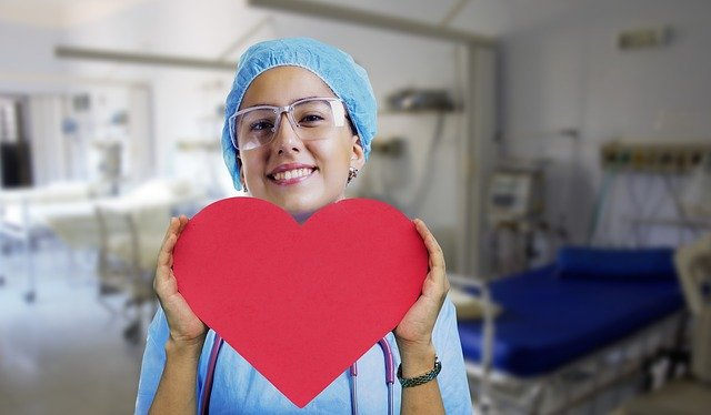 nurse holding paper heart