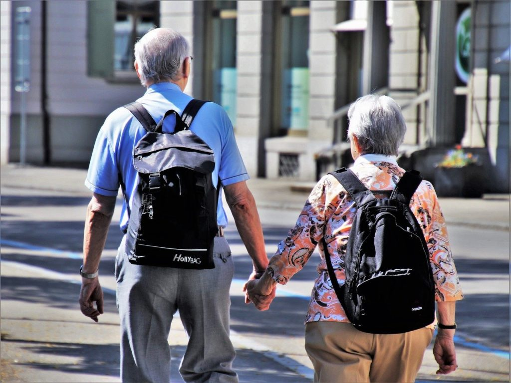 Man and woman walking with backpacks